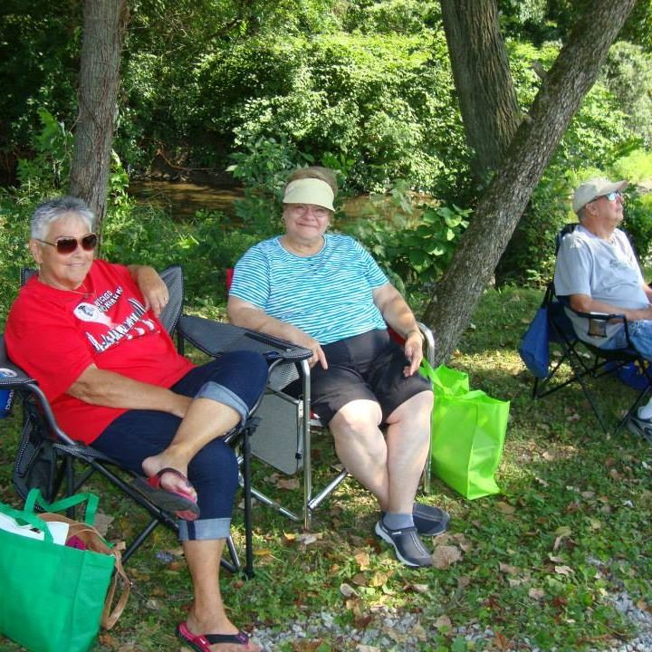 seniors relaxing and enjoying the picnic